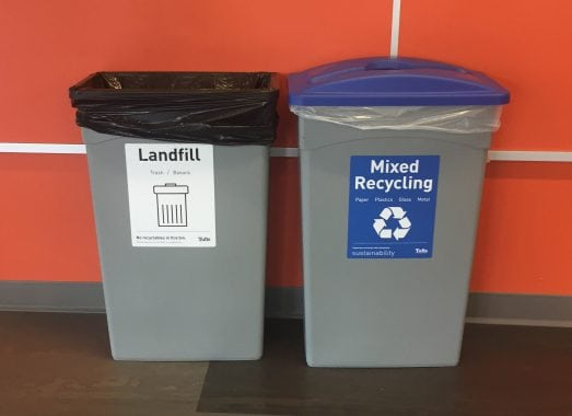 A mixed recycling waste station, with one landfill bin and one mixed recycling bin